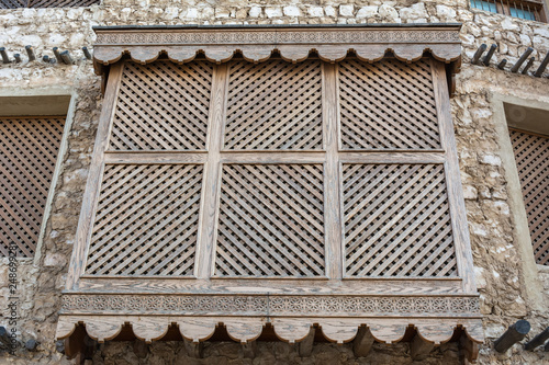 Fotografie, Obraz  Traditional Arabic mashrabiya balcony enclosed with carved wood latticework
