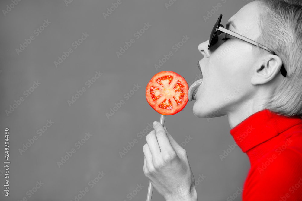 Fototapety, obrazy: Hot beautiful blond woman model  eating tomato, black and white with red clothes and tomato slice