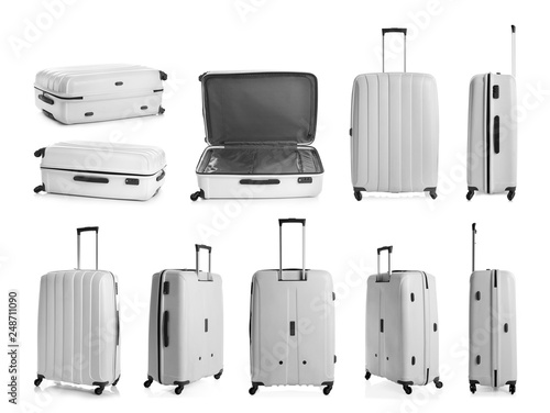 Fotografiet Set of stylish light suitcase for travelling on white background