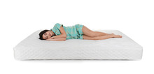 Young Woman Lying On Mattress ...