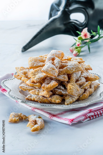 Fotografie, Obraz  Traditional Italian carnival fritters dusted with icing sugar - frappe or chiacc