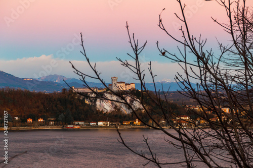 Fotografering  View of the Angera fortress at sunset