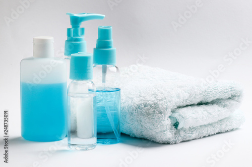 Garden Poster Spa cosmetic products and a towel on a white background