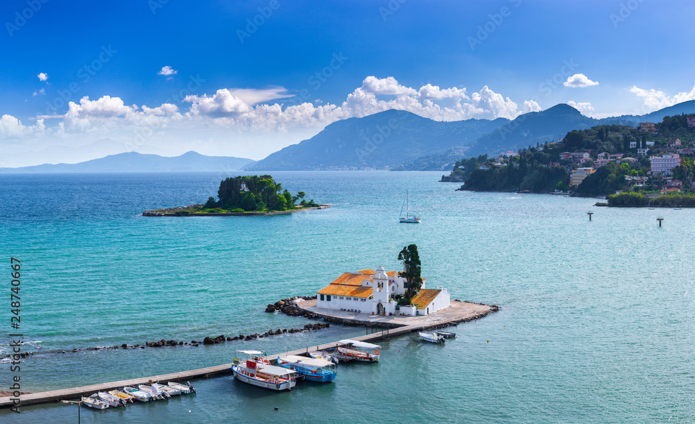 Fototapety, obrazy: Beautiful summer panoramic landscape aerial view of Vlacherna Monastery and island of Pontikonisi or Mouse island in Kerkyra. Green mountain slopes in Mediterranean sea. Corfu. Greece. Europe.