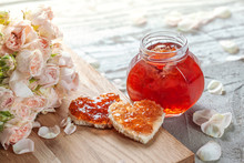 Rose Petal Jam And Heart Shaped Sandwich With Marmalade Rose Flower On Table.