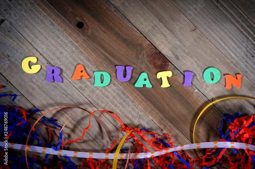 Fotografia, Obraz  Graduation design background with diploma on wood