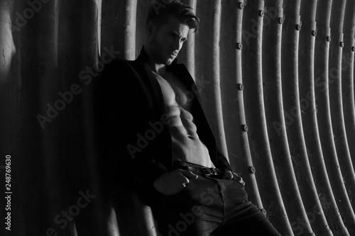Fotografie, Obraz Muscular young man with beard on dark tunnel urban background