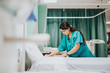 canvas print picture - Nurse making the bed at a hospital