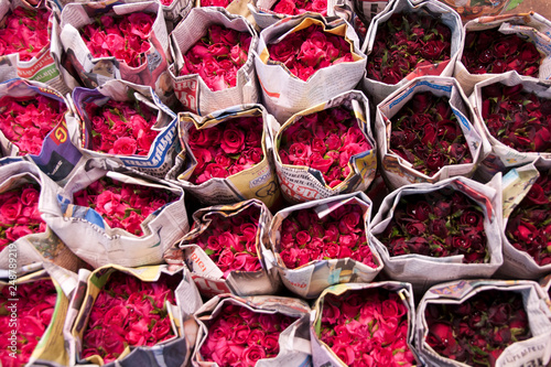 Bangkok Thailand, bunches of red roses wrapped in newspaper at the pak klong tal Canvas Print