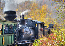 A Vintage Old Train With Thick Smoke Making Its Way Through The Forest In West Virginia. Shot Near Cass, WV, USA.