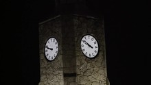 Daytona Beach Clock Tower Has Fireworks Exploding Behind It.