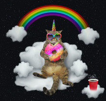 The Cat Unicorn In Sunglasses With A Color Donut Is Sitting On The Cloud Like A Divan. The Cup Of Coffe Is Next To Him. Stars Background.