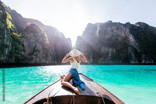 Beautiful woman making an excursion to phi phi island and maya beach in Thailand Wallpaper Mural