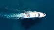 Aerial drone photo of luxury yacht cruise in mediterranean deep blue sea