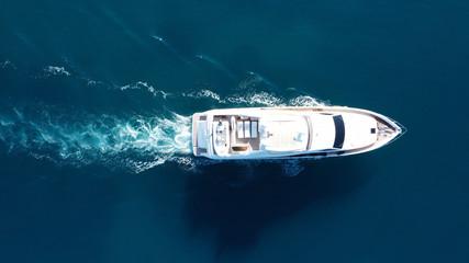 Aerial drone photo of luxury yacht cruise in mediterranean deep blue sea