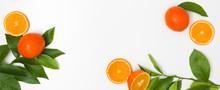 Fresh, Juicy Oranges With Gree...
