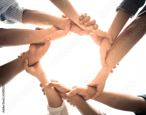 Photo  Close up of teamwork holding hands and supporting each other
