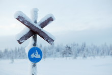 Frozen Sign Of The Snowmobile ...
