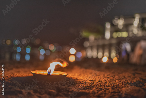 Fotografie, Obraz  Candela con bokeh di Luci - Spiaggia - Amore