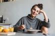 Beautiful young woman having healthy breakfast