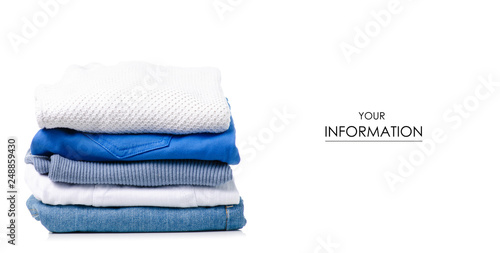 Fototapeta  Stack of clothing jeans sweaters pattern on a white background isolation