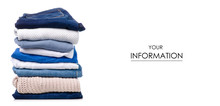 Stack Of Clothing Jeans Sweaters Pattern On A White Background Isolation