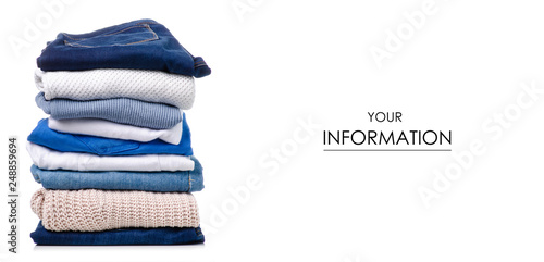Fényképezés Stack of clothing jeans sweaters pattern on a white background isolation