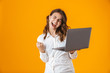 Leinwanddruck Bild - Portrait of a cheerful young woman wearing white shirt