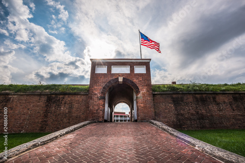 Historic American flying over the entrance to Fort McHenry National Monument, Ba Fototapeta
