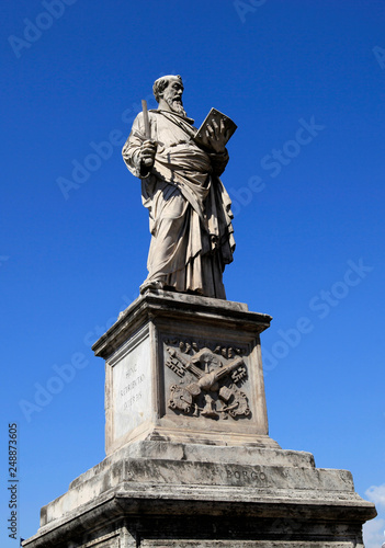 Fotografia  Statue on the Saint Angelo bridge over the Tiber river in Rome, Italy