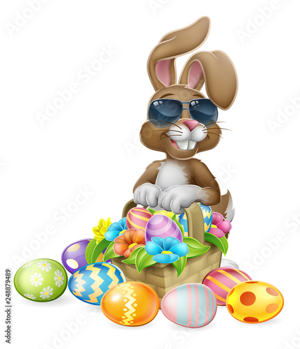Fotografie, Obraz  Easter bunny rabbit cartoon character in cool sunglasses or shades with a basket