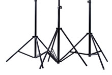 Studio Light Stands, Cropped Image. Photographic Equipment On White Background. Photography Studio Flash Kit.
