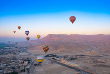Hot Air Ballons Over The Valley Of The Kings, Luxor, Egypt