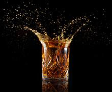 Liquor Glass Splashing Isolated On Black