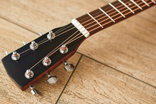 Uppermost Part Of The Guitar. Close View Of Guitar Headstock With Tuning Keys For Adjusting Guitar Strings
