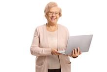 Happy Senior Woman Holding A Laptop Computer