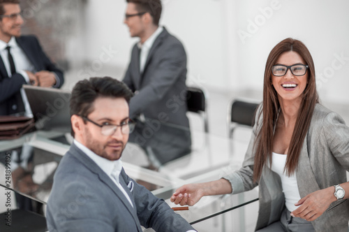 Fototapety, obrazy: businessman and business woman sitting at office Desk