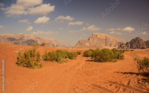 Deurstickers Oranje eclat bright vivid colors desert scenic landscape with yellow sand blue sky and mountain background