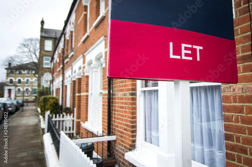'To Let' estate agent sign on residential street Wallpaper Mural