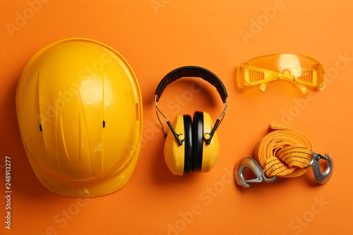 Fotografie, Obraz Flat lay composition with safety equipment on color background