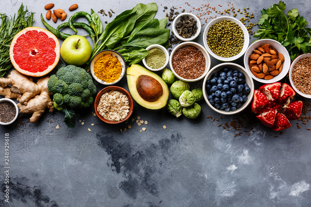 Fototapety, obrazy: Healthy food clean eating selection: fruit, vegetable, seeds, superfood, cereals, leaf vegetable on gray concrete background copy space