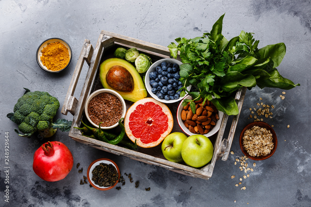 Fototapety, obrazy: Healthy food clean eating selection in wooden box: fruit, vegetable, seeds, superfood, cereals, leaf vegetable on gray concrete background