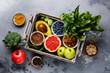 Leinwanddruck Bild Healthy food clean eating selection in wooden box: fruit, vegetable, seeds, superfood, cereals, leaf vegetable on gray concrete background