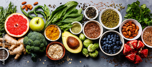 Cadres-photo bureau Nourriture Healthy food clean eating selection: fruit, vegetable, seeds, superfood, cereal, leaf vegetable on gray concrete background