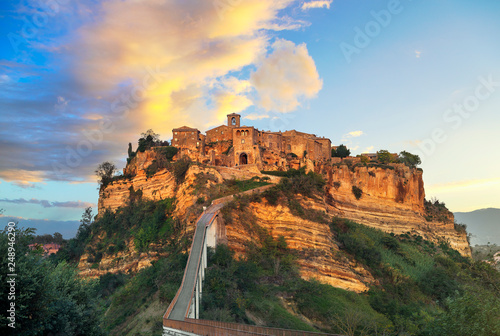 Civita di Bagnoregio landmark, aerial panoramic view on sunset Fotobehang