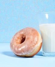 Glazed Donut Leaning Against G...