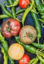 Heirloom Tomatoes And Chili Peppers