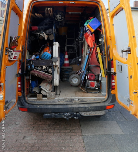 Cargo space of a construction vehicle, loaded with various