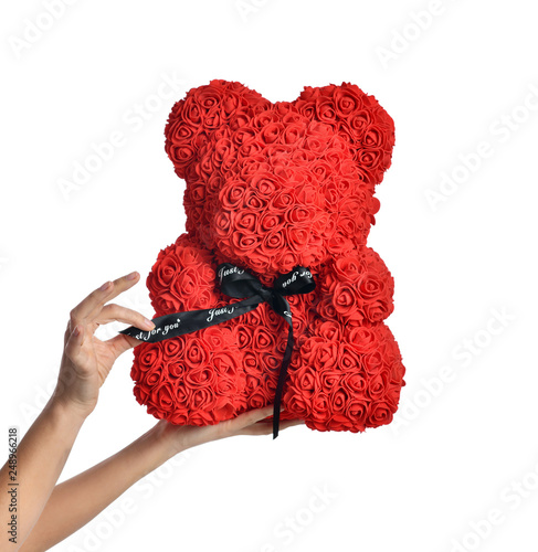 Woman hands hold red bear of roses present gift for valentines day or birthday isolated on white