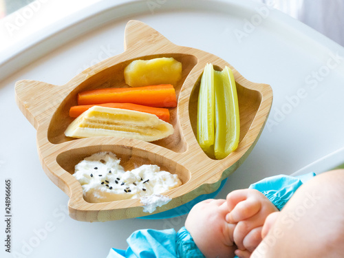 Fotografija Baby eating by hands, Baby eating organic bio vegetables with BLW method, baby led weaning